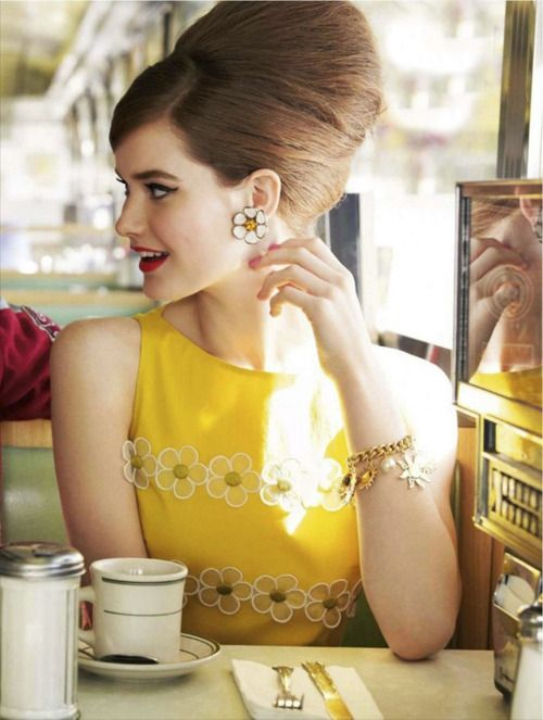 Daisy earrings and dress, 1960s poof hairstyle.