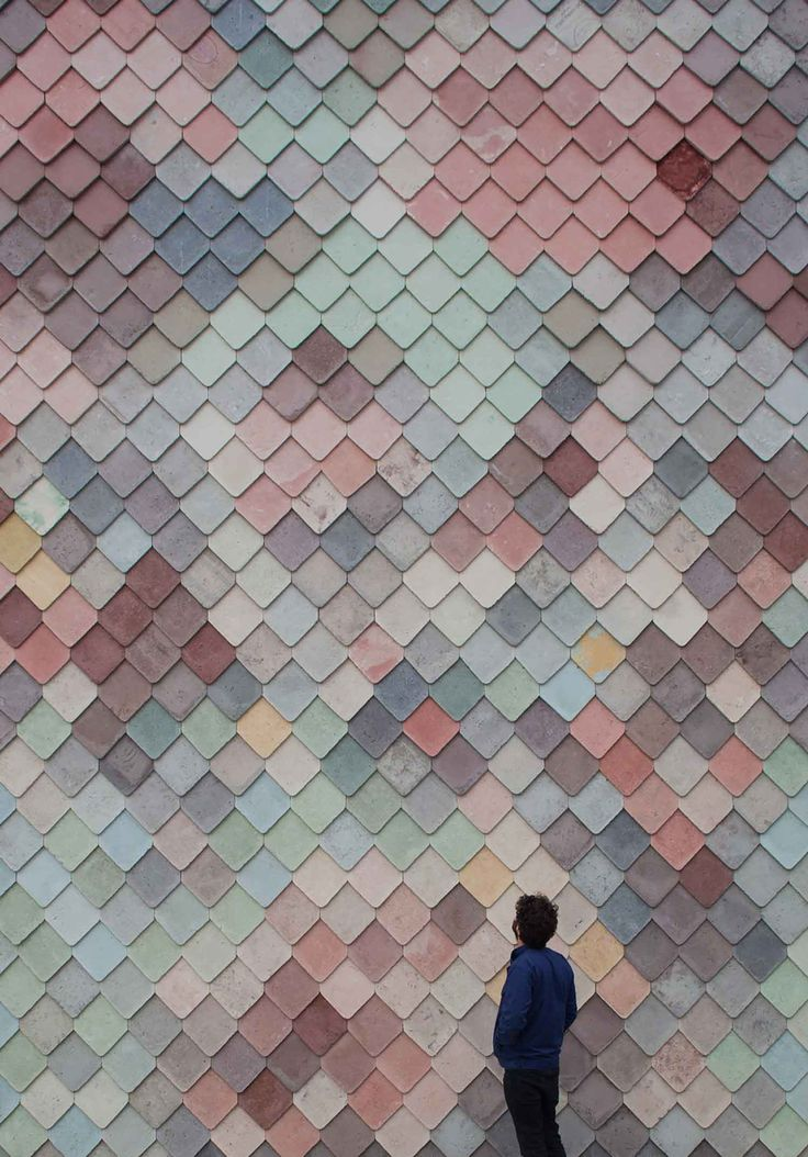 Sugar House Studio's, East London. Multi colored concrete tiles made by hand on the site. Took 4 months to assemble to the exterior wall. I love this ! <3 the colors are so soft and muted which pleases my eye.