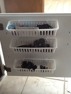 add small baskets on the inside of cabinet doors to hold those small items like hair supplies, makeup, etc...