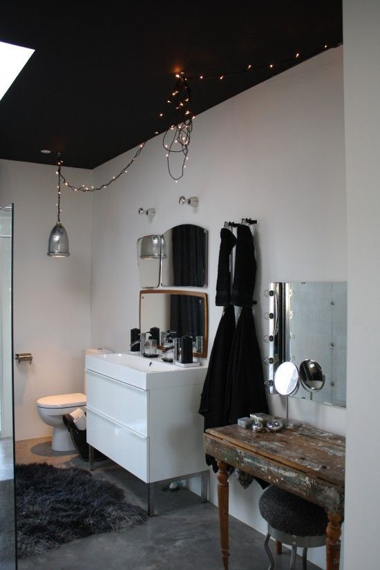 A Black Ceiling in this Bathroom Creates and More Human Scale