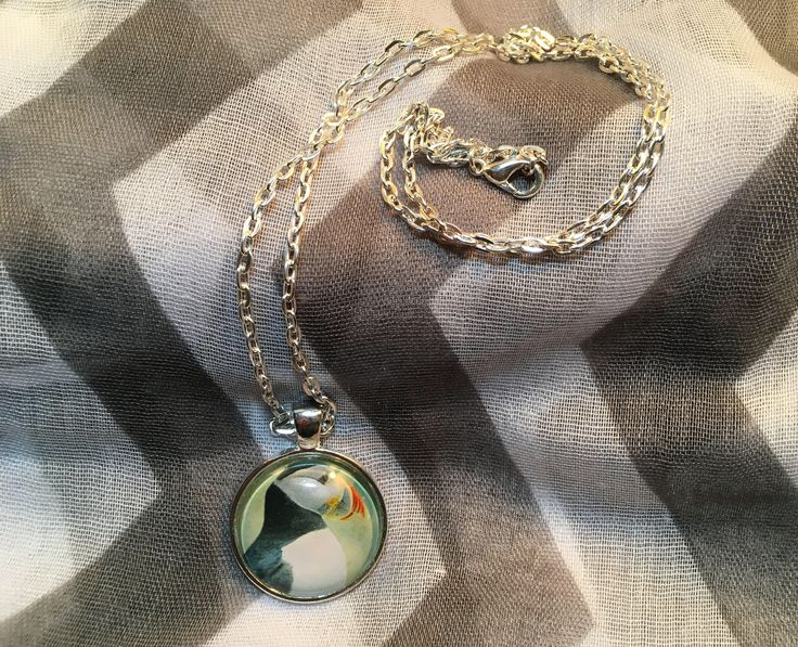 Handmade - PUFFIN - Shiny Silver Bezel Pendant w/ Shiny Silver Chain Necklace - Jewelry by SaltyAirInspirations on Etsy https://www.etsy.com/ca/listing/526264320/handmade-puffin-shiny-silver-bezel #Puffin #Necklace #Bezel #Pendant #souvenir #Newfoundland #Handmade