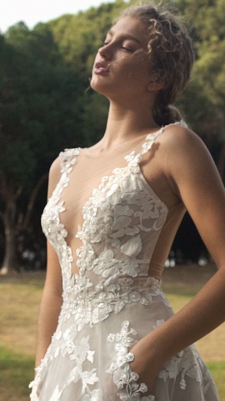 The #GALA210 is an embroidered tulle ballgown with embroidered lace trimming and immense floral patterns, this dress has a plunging V neckline, drop low back and hidden pockets. Also recommended with the #GALA214 matching veil.
