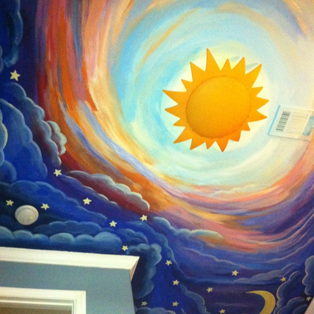 Painted this on my son's ceiling. It's a nighttime sky going into a daytime sky and I bought the cool sun light fixture from Ikea.