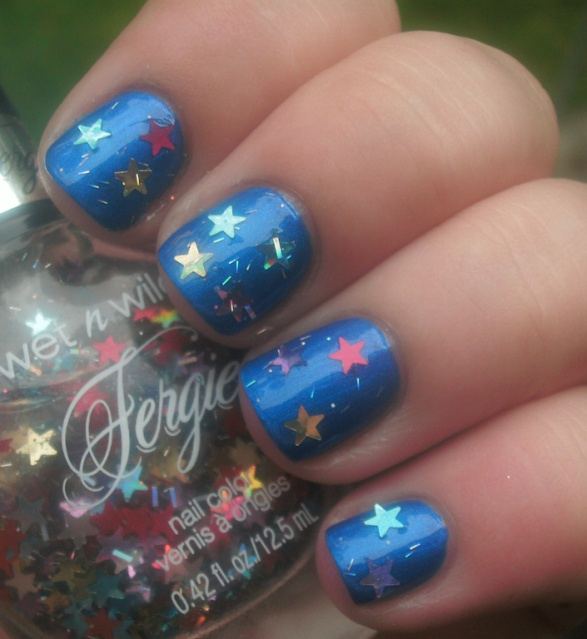 Wet n Wild Fergie Collection - Hollywood Walk of Fame, swatched on nail wheel.  Clear base with stars and bars, $3