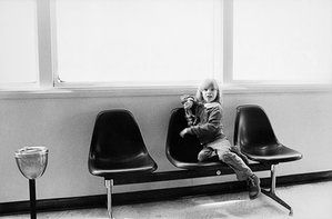 Bowie's five-year-old son, Zowie (Duncan Jones), passes time in an airport lounge by playing with his action figure toy between stops on the tour in 1976