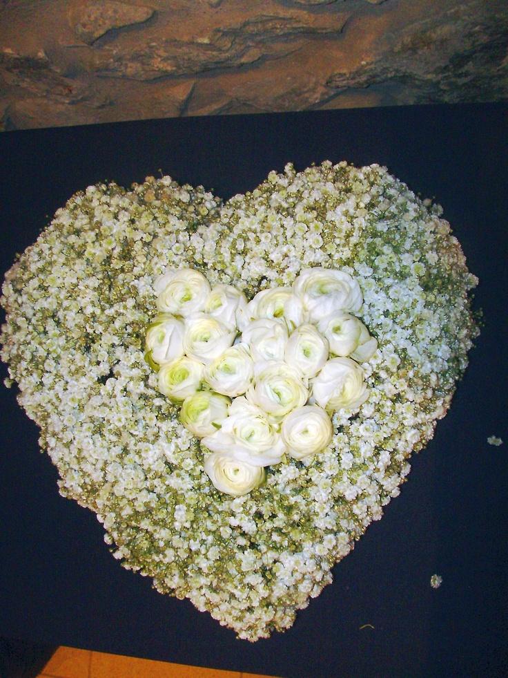 Moustakas flowers-Wedding heart with gypsophila and ranunculus #weddingflowerheart #weddingideas #weddingdecor #gypsophila #ranunculus
