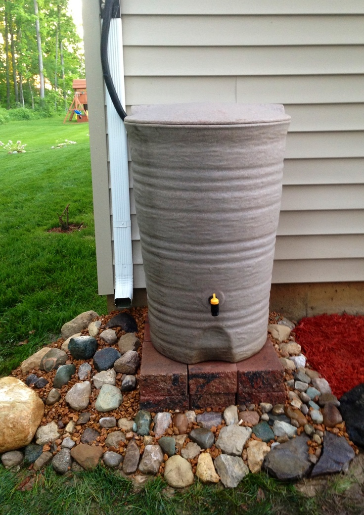 We completed our rain barrel stand. The design is very dramatic.