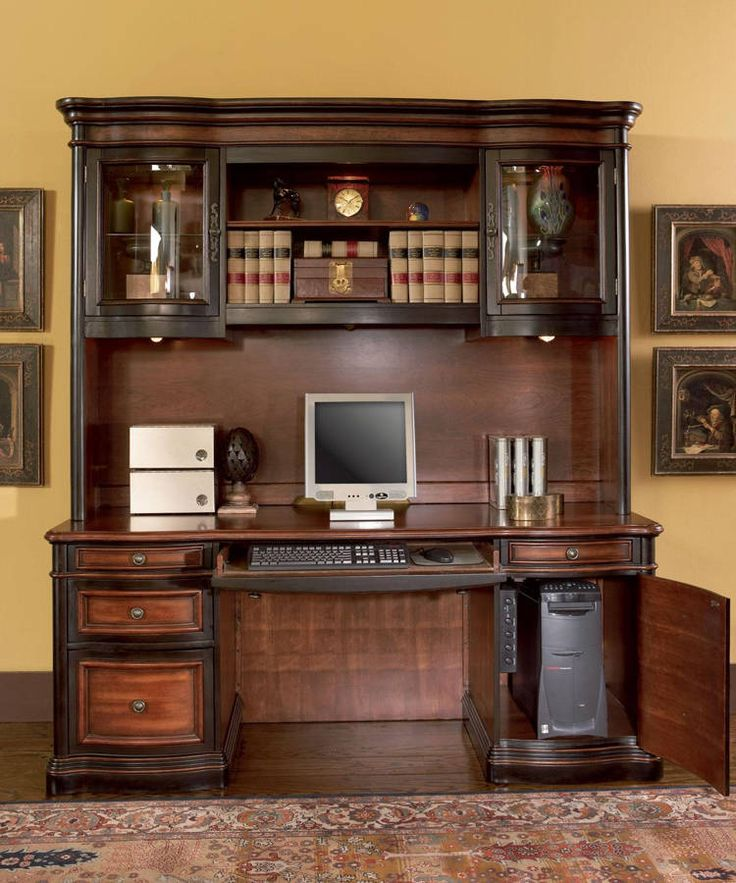 the yellow walls provide a great backdrop to this gorman traditional espresso brown wood credenza