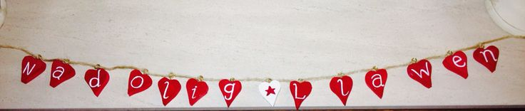Handmade and homespun - Merry Christmas garland in Welsh.