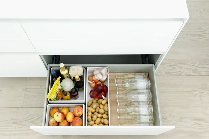 The bulthaup b3 interior fitting system is relevant for small and large drawers alike. In this photo the oak fitting system complements the white b3 kitchen finish. Storage is maximized with fitted containers. www.bulthaup.com #bulthaup #kitchens #modernkitchens