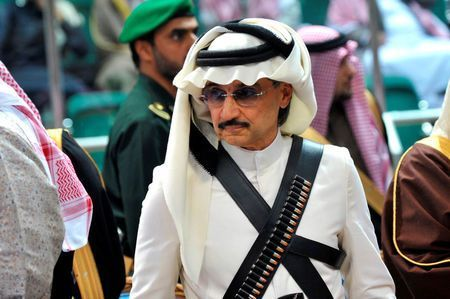 Saudi business magnate Prince Alwaleed bin Talal on Thursday put aside his bitter clash with Donald Trump and embraced the Republican U.S. president-elect, saying he was heartened by reports that Trump had appeared to delete online references to his proposed ban on Muslims.  Prince Alwaleed, in a wide-ranging