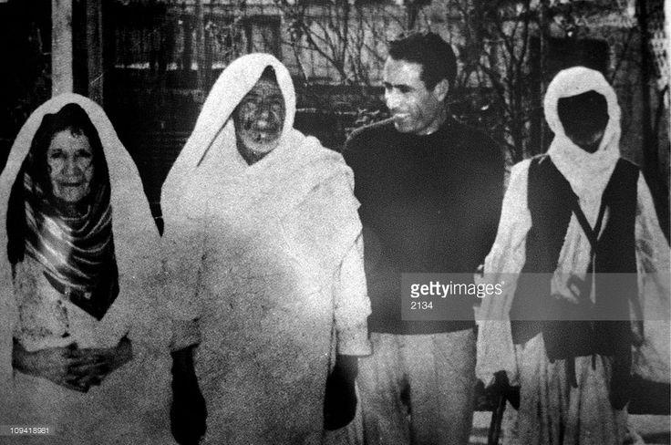 Muammar Gaddafi with his parents