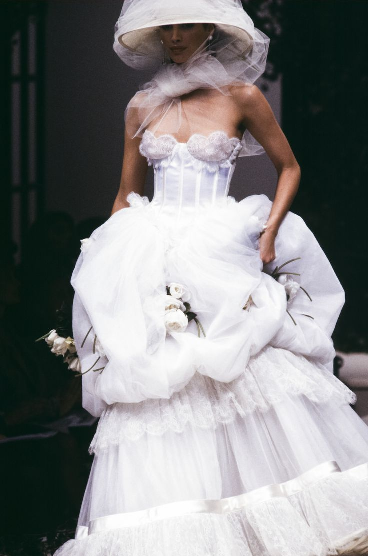 With a few hours to go until Pierpaolo Piccioli's first solo haute couture collection for Valentino, we look back at the label's most stunning haute couture wedding gowns from 1990 to 2016.