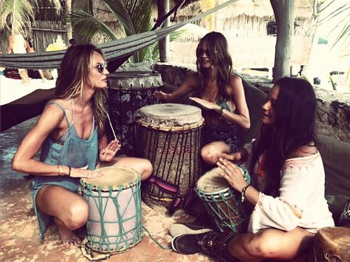 Candice Swanepoel and Behati Prinsloo getting drum lessons while in St. Barts