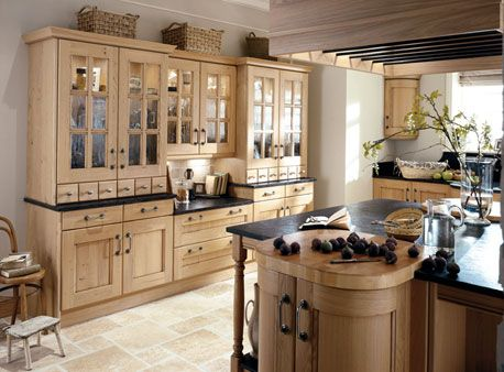 rustic styling and knotty oak finish make it a very welcoming kitchen that's full of natural charm.