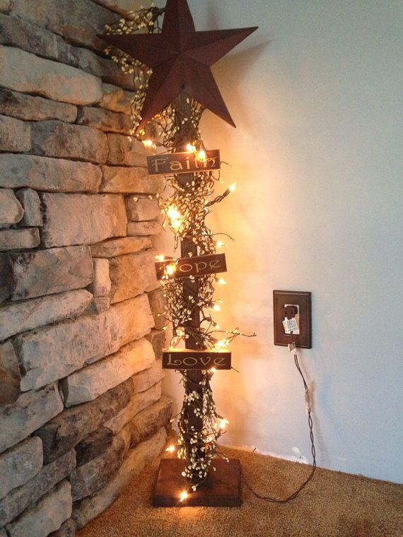 Barn star lighted decoration use wire to attach icicle lights on to pole. Paint pole black. screw on a base.