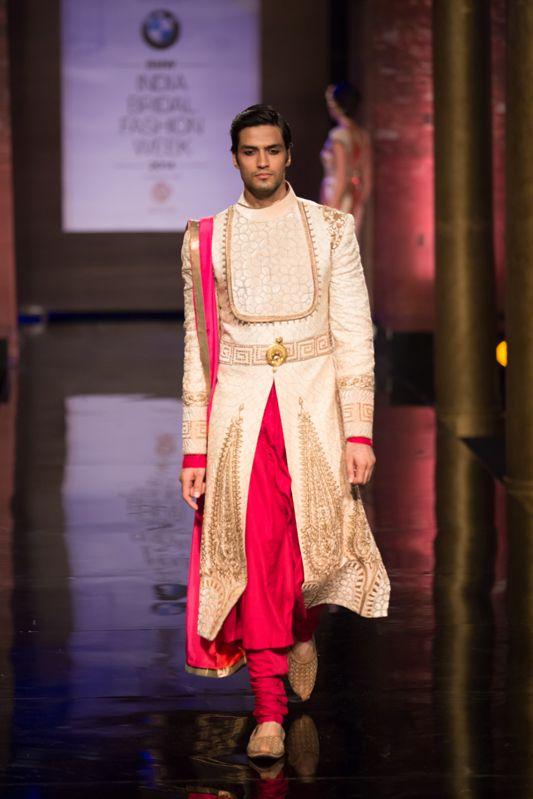 Pink and white Indian groom sherwani by JJ Valaya at India Bridal Fashion Week. More here: http://www.indianweddingsite.com/bmw-india-bridal-fashion-week-ibfw-2014-jj-valaya/