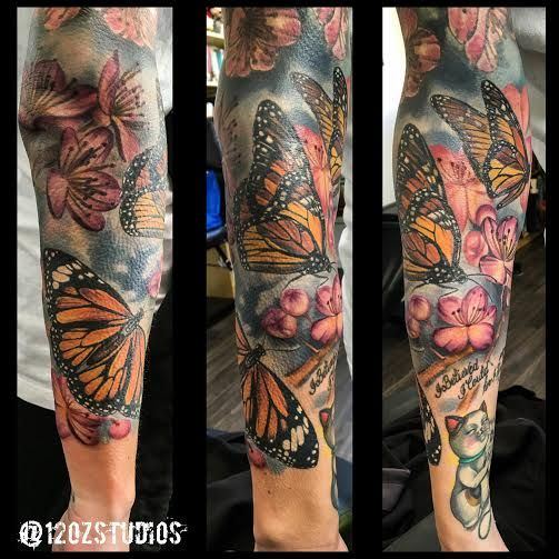 incredible full sleeve tattoo featuring monarch butterflies and a floral background by meghan. Black Bedroom Furniture Sets. Home Design Ideas