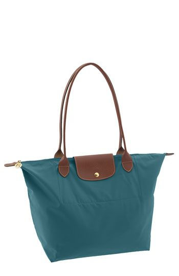 Longchamp bags are one of my favorite brands.  The Le Pliage totes fold up for travel, come in great colors, all different sizes.  they are not exactly cheap, but I feel well worth the investment for a great looking classic tote you can dress up or down.