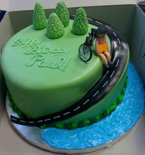 Cycling Enthusiasts Birthday Cake - Everything is fondant except for the bike.  I tried and failed at making the bicycle so I ended up just buying one at the local cake store.