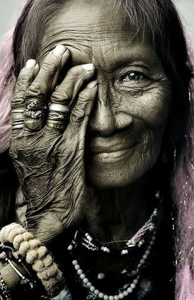 Something about this pic reminds me of my grams...maybe it's all the rings she's wearing. But I like it