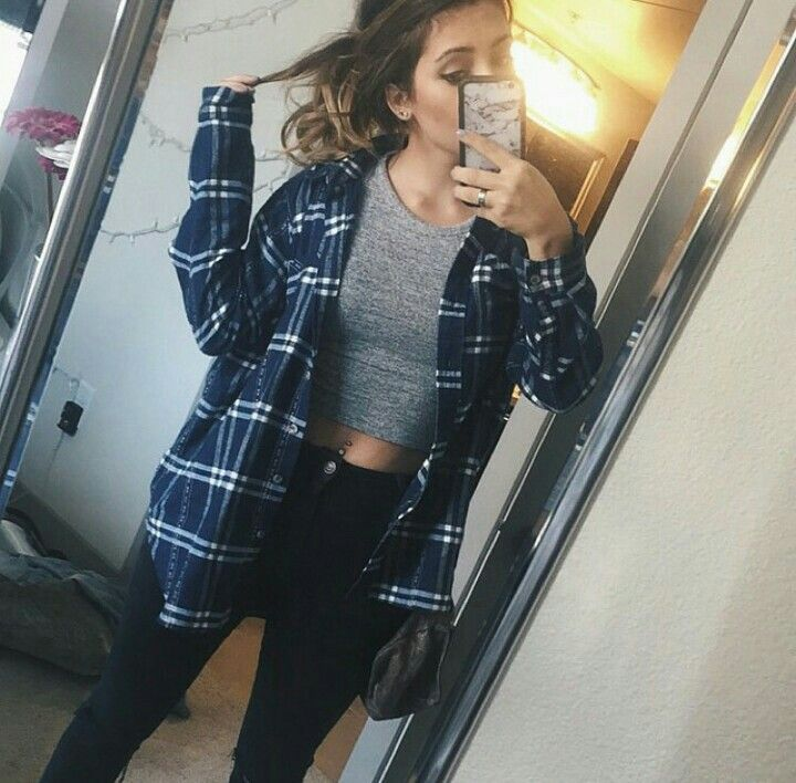I just love Tara Michelle's (Tara Massicotte) style. She is another vlogger I watch. Here's her vlog channel : https://www.youtube.com/user/taramichellevlogz She has 224,205 subscribers on her channel. She is from toronto, Canada and is 21 yrs. old, She now lives in Los Angeles, California.  One of her besties is fellow YouTuber, Remi Cruz. In this photo she has a gray crop top with a blue/white flannel layered over it, Then she has black skinny jeans and a simple ponytail on. #Cute