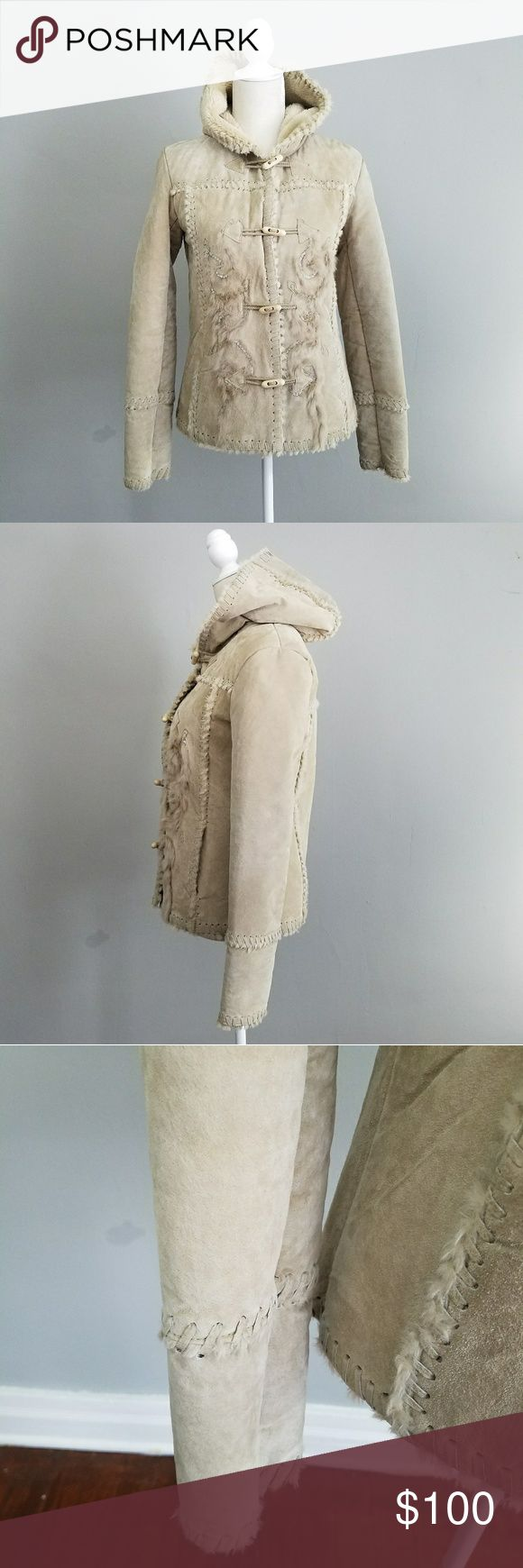 Naf Naf | rare pigs leather shearling coat French designer is hard to get in the US. Excellent condition, small blemish on lower back as seen. Pigs skin and faux fur. Stitched together.  Cute toggles with embroidered detail. extra button included. French medium is closer to a small. Jackets & Coats