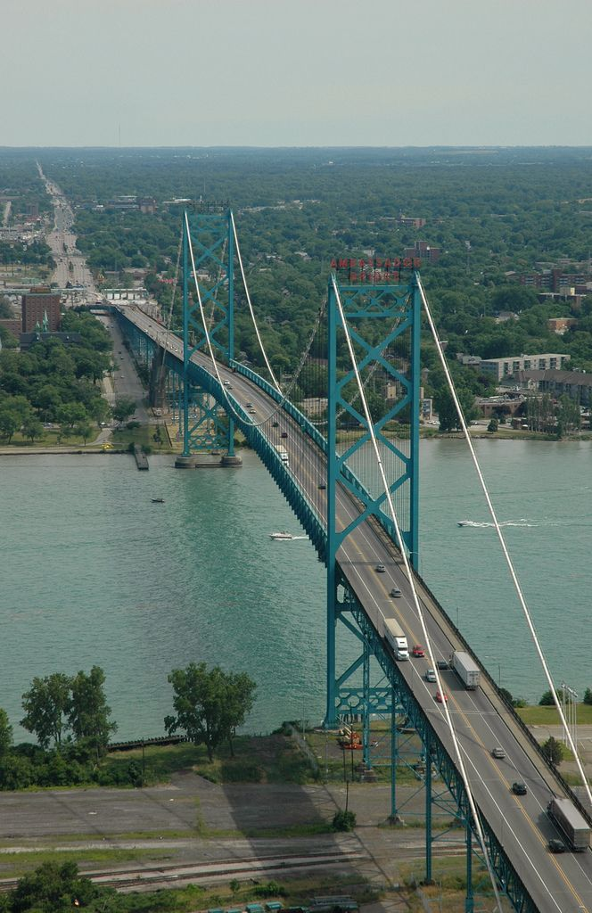 Ambassador Bridge in Detroit, Michigan - photo by Ian Freimuth (ifmuth), via Flickr; This is a suspension bridge that connects Detroit, Michigan, in the U.S., with Windsor, Ontario, Canada. It is the busiest international border crossing in North America in terms of trade volume: more than 25 percent of all merchandise trade between the United States and Canada crosses the toll bridge. The bridge opened in 1929. Its central span is 1,850 feet and its total length is 7,500 feet.