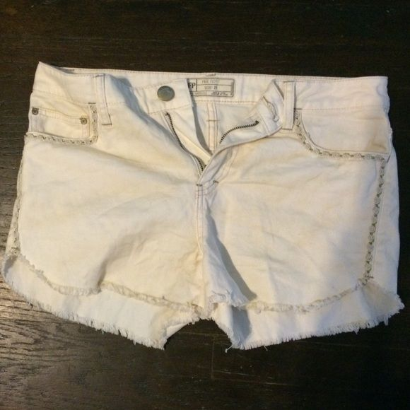 Cream shorts: Free People Cute cream shorts with cute stitching design. Never been worn. In great condition. Free People Shorts Jean Shorts