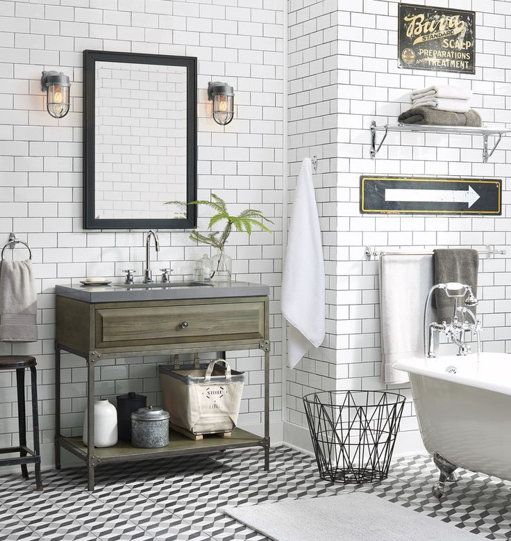 Vintage Industrial Bathroom With White Subway Tile And Vintage Signs