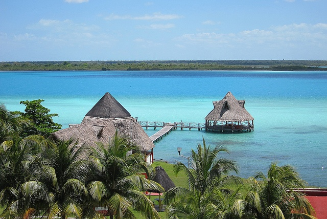 Laguna Bacalar (Mexico).  'The sun blazes above you as you camp out along the shores of the larger-than-you'd-imagine Laguna  Bacalar. The white-sand bottom creates amazing visibility and makes for good afternoon  swims.' http://www.lonelyplanet.com/mexico/yucatan-peninsula/laguna-bacalar