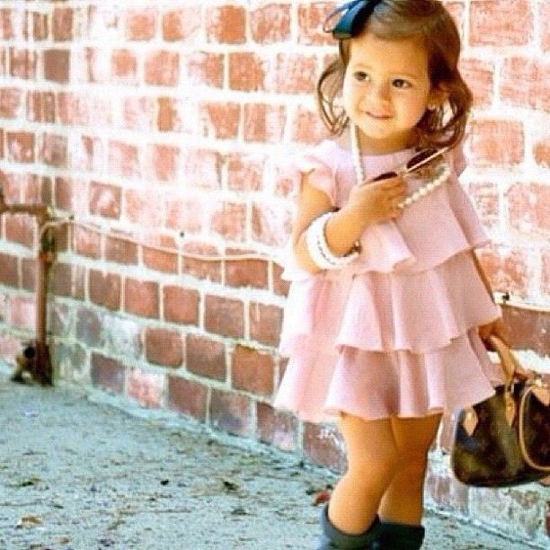 dress is cute :) don't know how I feel about all the jewelry and a LV bag for a toddler though...