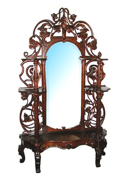 Antique 19th C. pierce-carved rosewood Victorian Rococo Revival etagere. This is a wonderful piece particularly because of its high quality. Very elegant with a very sturdy build that has a delicate look and feel.