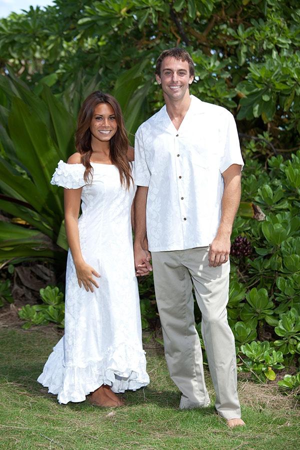 Matching Ruffle Shoulder Wedding Muumuu And Hawaiian Shirt In Front Of Some Massive Beach