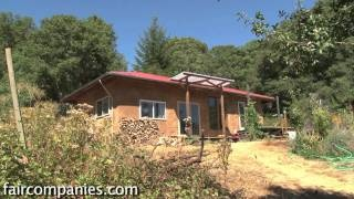 An earth-built passive solar house: cob (south), strawbale (north), via YouTube.