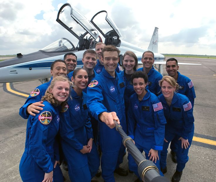 NASA's 2017 Astronaut Candidates NASA's 2017 astronaut candidates take a group photo at Ellington Field near Johnson Space Center. Pictured are front row left to right Zena Cardman Jasmin Moghbeli Robb Kulin Jessica Watkins Loral O'Hara; back row left to right Jonny Kim Frank Rubio Matthew Dominick Warren Hoburg Kayla Barron Bob Hines and Raja Chari.