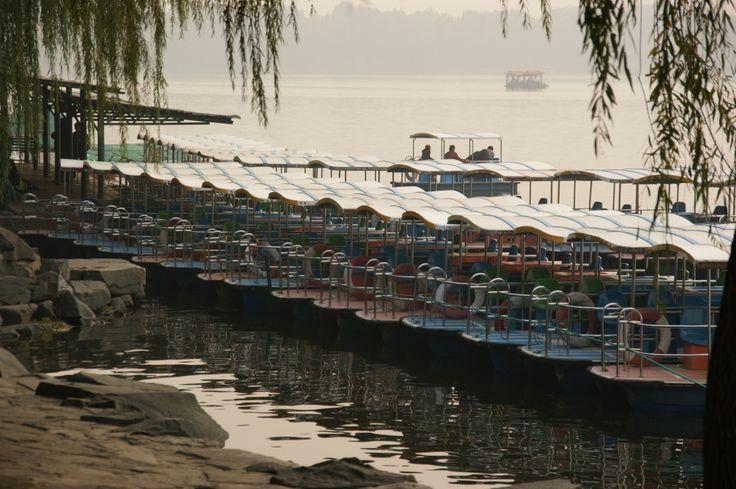 Pleasure boats on Lake Kunming, Summer Palace, Beijing, China. October 2011