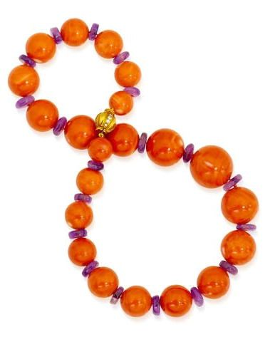Property from various owners A coral and amethyst bead necklace, Bulgari comprising twenty-one graduated round coral beads each with rondell amethyst spacers; signed Bvlgari; clasp mounted in eighteen karat gold; length: 18 3/4in.
