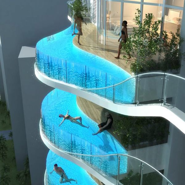 Whoa.  Could you? Would you? Aquaria Grande is a concept drawing of a condo building being built in Mumbai India. Expected to be completed this year, the Aquaria Grande, a 37-story residential skyscraper in Mumbai, India, will have a feature like no other condo in the world… glass swimming pools on your balcony right outside you apartment.