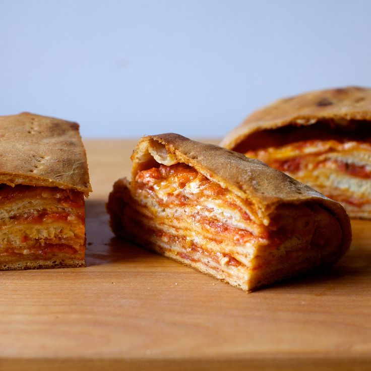 New recipe, Stromboli: A very layered one, inspired by the scaccia ragusanas of Sicily. This one is deeply American, however, with the flavors and toppings of a great pepperoni pizza and I show you two ways to make it: a humble packet that looks like a pizza croissant inside, and a rustic-looking loaf that is basically a pizza babka. Why choose? Make both. [Link to Stromboli on smittenkitchen.com in profile]