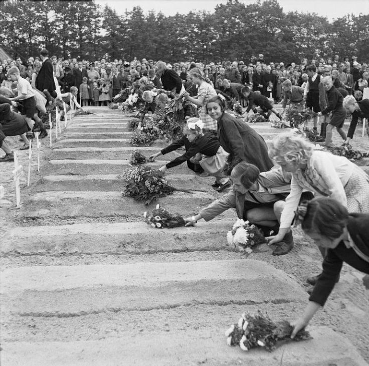 British Airborne Division at Arnhem and Oosterbeek in The Netherlands. Dutch children pay their respects to the fallen and lay flowers on the graves.