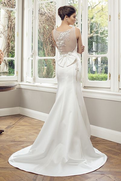Fluted gown with illusion back and beaded embroidery by Mia Solano, $999.Check out more gorgeous dresses in our Mia Solano wedding gown gallery ►