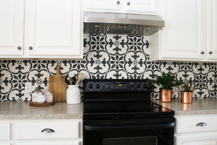 Learn how to stencil the Fabiola Tile Stencil from Cutting Edge Stencils on a kitchen backsplash. http://www.cuttingedgestencils.com/fabiola-tile-stencil-spanish-portugese-tiles-stencils.html