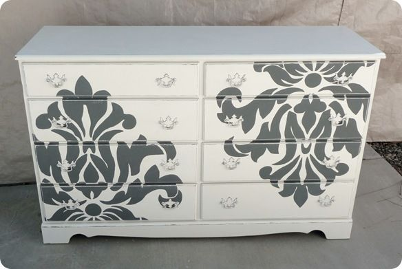 Shabby Take on the Damask Dresser from Twice Lovely - she used the projector method, like I did for the girls wall, with a piece of damask fabric.  Also used a dresser that looks identical to the girls dresser... hmmmm... maybe we should fancy that thing up a bit :P