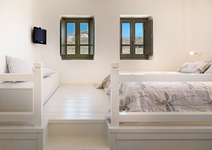 wooden windows with interior shutters to hotel in Folegandros, Greece