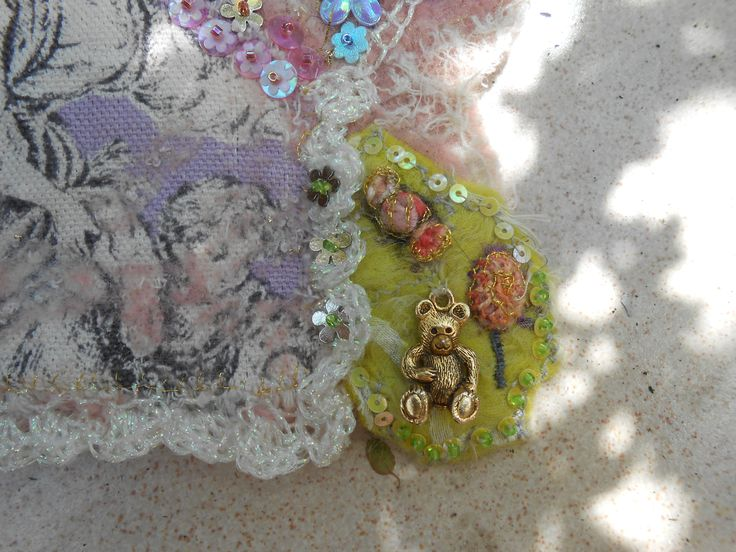 And here the detail of tiny stumpwork sweets and bear charm.