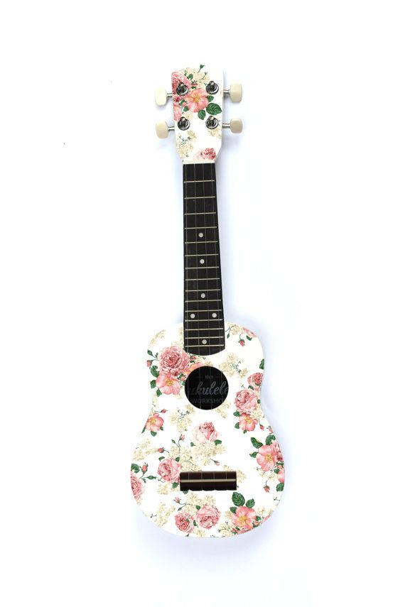 The perfect girly ukulele! The pink rose ukulele has a beautiful floral covered front, back and head.    Our ukuleles are made with quality