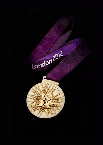 London Olympic Medals http://nbcnews.to/PmDVp0 #NBCOlympics  Tim's Comments: I like this medal because  it is very bright when you look at it and the olympic sign is on it. I dislike the background because it does not stand out. This gold medal is made out of 92.5% silver and 1.34%gold with the remainder is copper.