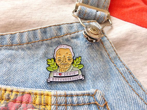 Show the world your love for Sir David Attenborough with this cute little enamel pin badge! Made from soft enamel this pin is made from my original illustration and is a kooky treat treat for your eyes. It is a fun, playful and unique pin that will delight seekers of alternative