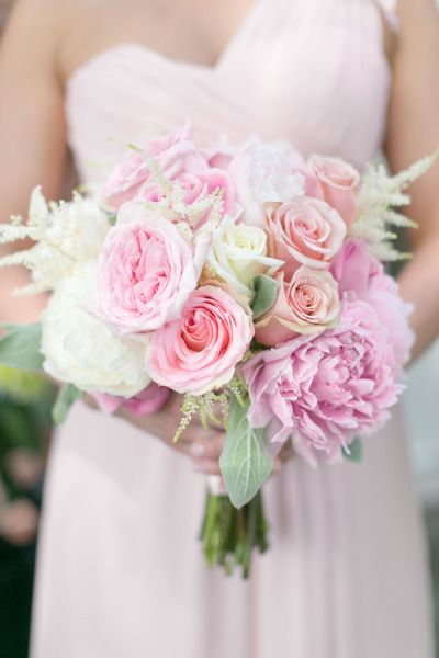 Lush pink peony and rose bridesmaid bouquet: http://www.stylemepretty.com/little-black-book-blog/2014/07/25/classic-candlelit-lake-forest-wedding/ | Photography: Heather Cook Elliott - http://heathercookelliott.com/